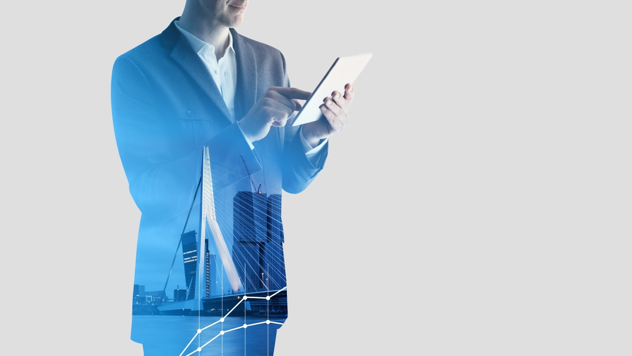 background showing men holding tablet with inlayed buildings